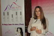 UK Singing Sensation Emma next to NubeautyCare Cosmetic Line Sponsor Banners Hermitage